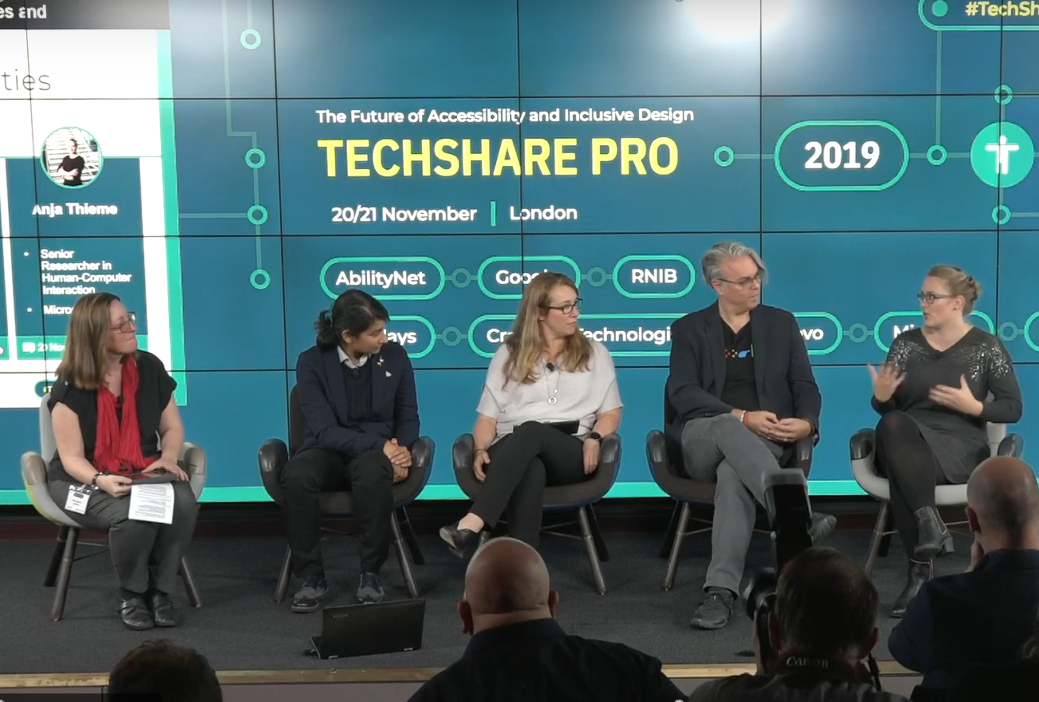 Image showing all the techshare panelists next to each other sitting on the conference stage